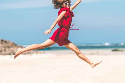 woman in red jumping